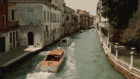 Venice, Italy - July 1, 2018: Panoramic view of Venice narrow canal with historical buildings and Footage