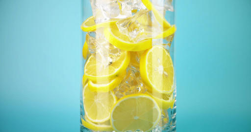 Making ice cold lemonade in a big glass, close-up slow motion shot on Red Live Action