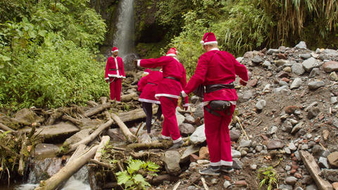 Santa Claus Followers On A Waterfall Live Action