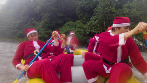 Santa Claus Rafting Team Working Together Live Action