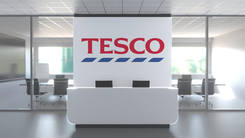 Logo of TESCO on a wall in the modern office, editorial conceptual 3D animation Live Action