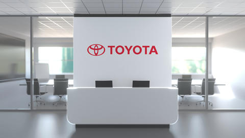 TOYOTA logo above reception desk in the modern office, editorial conceptual 3D Live Action