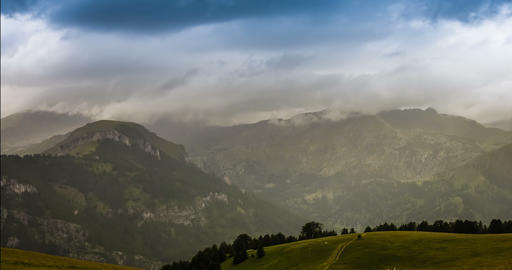 4K, Time Lapse, Godrays And Rain Over French Mountainrange Footage