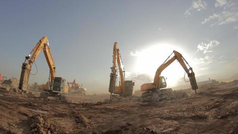 Hydraulic hammer breaker on excavator destroying rocks Footage
