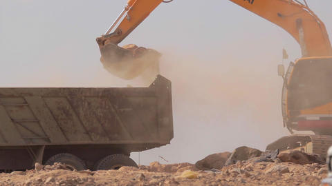 Excavator scoop loads a dump truck Footage