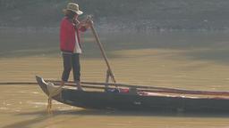 Woman peddles canoe fisherboat in river,Battambang,Cambodia Footage