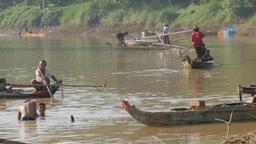 Fishermen fishing in Sanker river in canoe,Battambang,Cambodia Footage