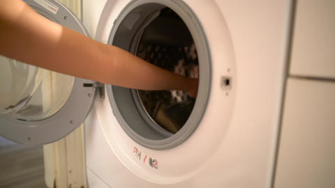 Take dirty cloths to washing machine Footage