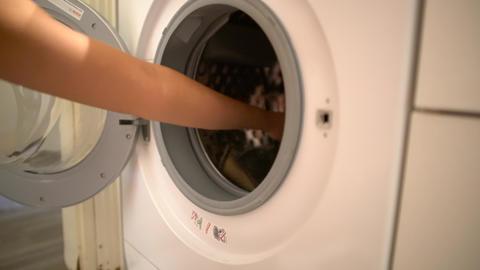 Take dirty cloths to washing machine Footage