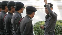 Police officer gives instructions,Bangkok,Loi Krathong,Thailand Footage