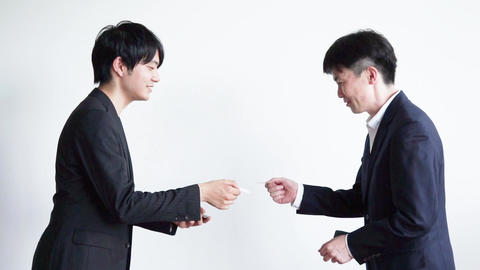 Two businessmen to exchange business cards Stock Video Footage