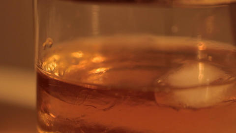 The ice is melting in the whiskey Footage