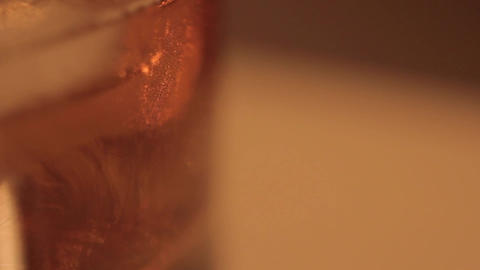 The ice is melting in the whiskey - Time Lapse Footage
