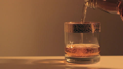 Whiskey being poured into the cup Footage