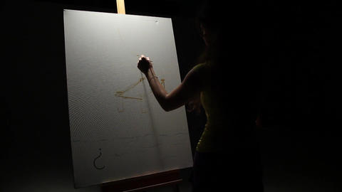 Woman artist painting with paintbrush in Studio - Fast Footage