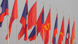 Lao national and communist flags in light wind,Vientiane,Laos Footage