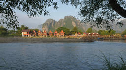 Karst mountains and bungalows with motorcycle riding,Vang Vieng,Laos Footage