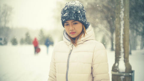 Young Asian Woman in winter park slowmotion Footage