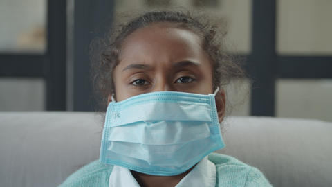 Ill girl wearing mask to prevent spread of germs Footage