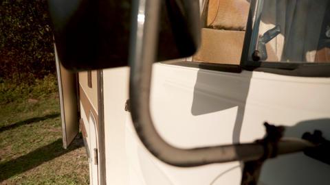 Girlfriend going inside of their retro camper van Footage