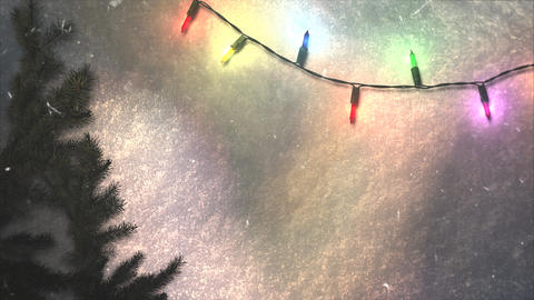 Animated closeup colorful garland and Christmas green tree branches on snow background CG動画