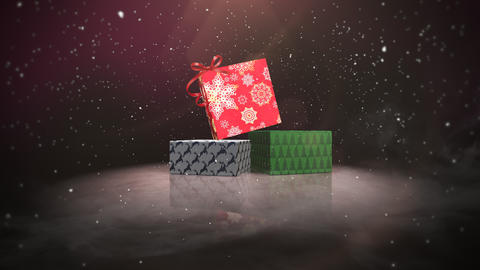 Animated closeup Christmas gift boxes on snow and shine background Videos animados