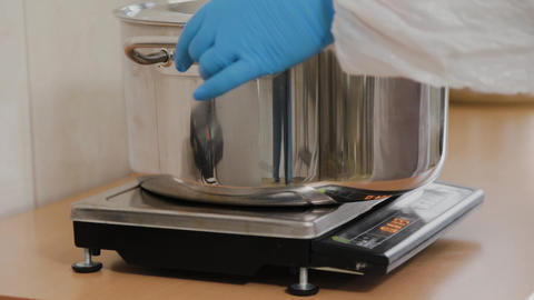 Female scientist weighs ingredients for preparing medicine Live Action