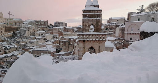 panoramic view of typical stones Sassi di Matera and church of Matera 2019 with snow on the house, ビデオ