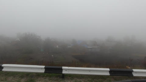 Pov driving view in fog on side on village Footage