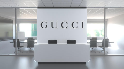 Logo of GUCCI on a wall in the modern office, editorial conceptual 3D animation Live Action