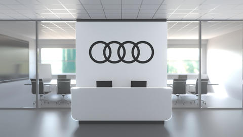 Logo of AUDI on a wall in the modern office, editorial conceptual 3D animation Live Action