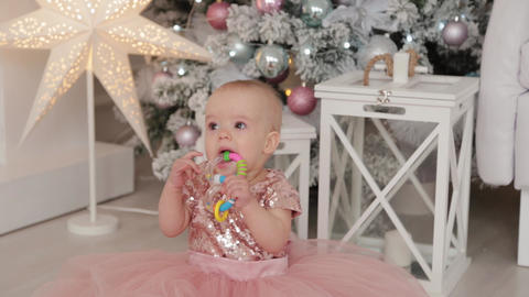 Beautiful one-year-old girl in a New Year's decor. Happy New Year 2020 Live Action