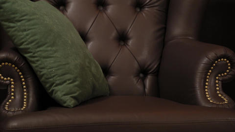 Elegant saturated glossy gold leather texture of sofa chair, Brown leather Footage