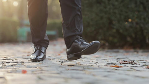 Closeup of luxury shoes, businessman walking, elegant rich person. Man in black Live Action
