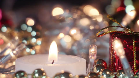 candle and christmas lights close-up seamless loop Footage