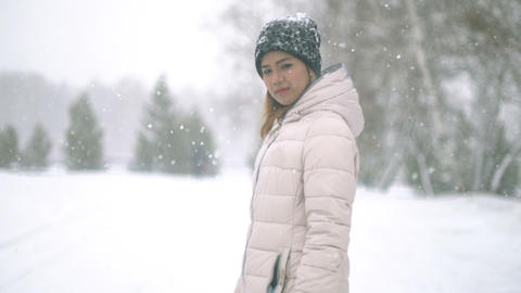 Young Woman during snow storm Footage