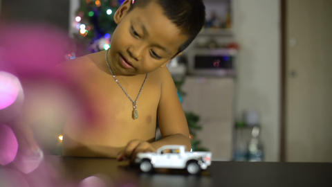 Little boy playing with toy car Footage