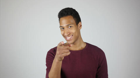 Happy Young Man Pointing with Finger, Smiling Footage