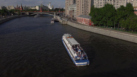 Reach of Moscow river near Kremlin, tilt up from touristic river boat Footage