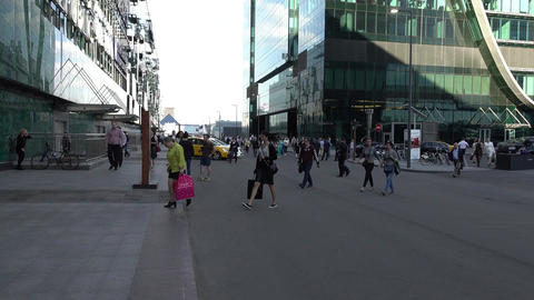 Office workers quickly go out from office tower, hurry to get home at end Footage