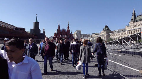 POV walk with citizens stroll at Red Square, slow motion, scaffold disassemble Live Action