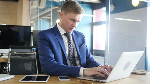 Businessman working on laptop computer in the office Footage