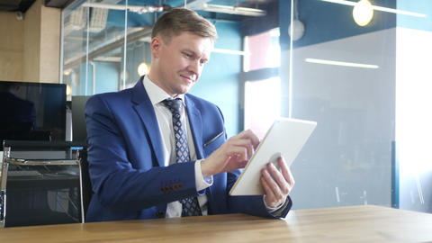 businessman using tablet computer touchscreen in office Footage