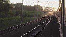 Suburban train at sunset Footage