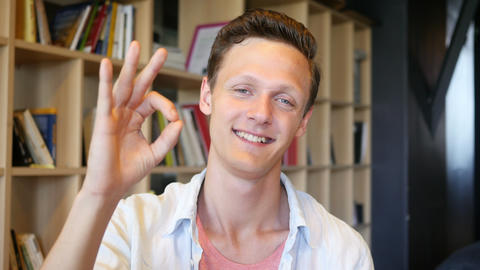 Young happy student showing Ok sign Footage