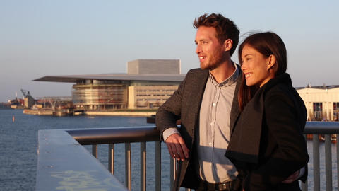 Europe couple enjoying sunset view at Copenhagen harbourfront by the Opera house Live Action