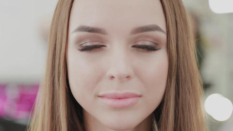 Beautiful portrait of a girl after makeup in a beauty salon Live Action