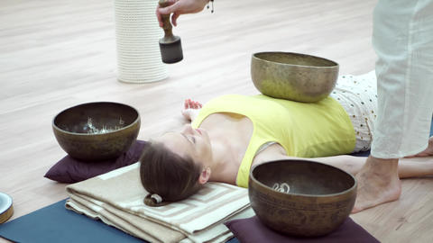 Woman Practicing Yoga Meditation with Singing Bowl Live Action