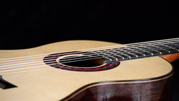 Detail of frets, string, body, mouth and bridge of typical classic spanish guita Footage