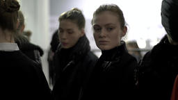 Girl model is waiting for the start of the show . Backstage fashion show Footage